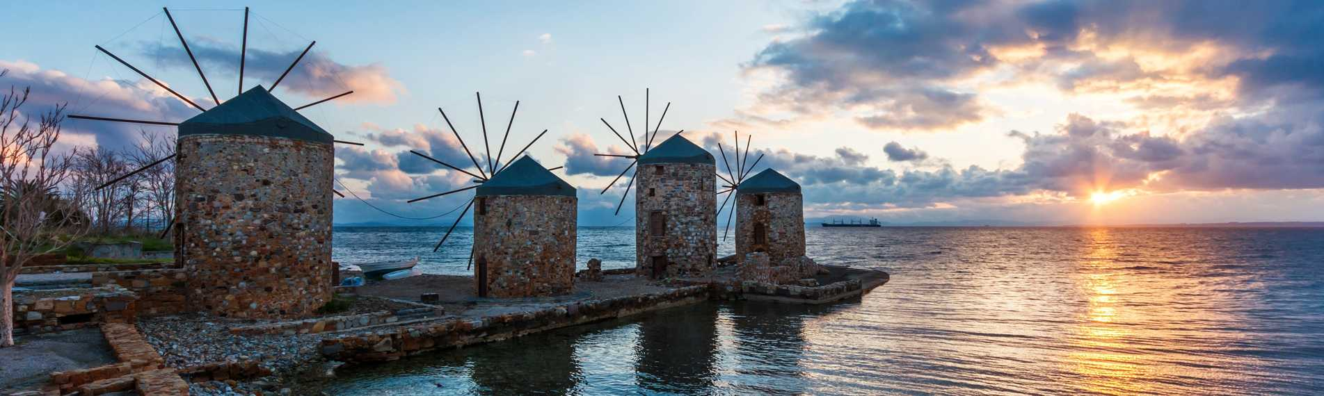Four mills by the sea at sunset on ​​the island of Chios